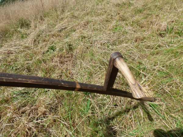 Close-up of a scythe