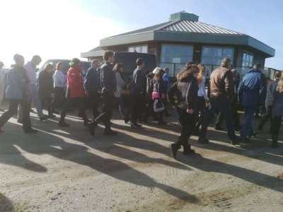 Some of the participants head back indoors after a quick group photo in the sun at the Your Shore conference